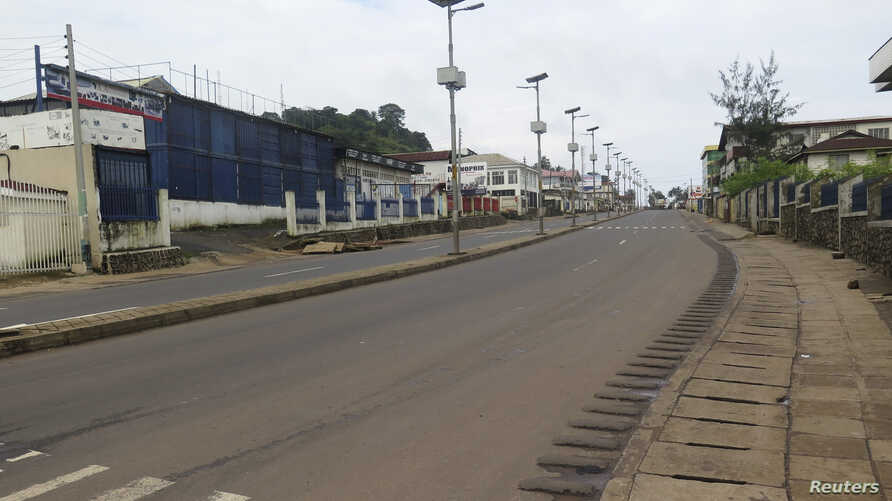An empty street is seen at the start of a three-day national lockdown in Freetown, September 19, 2014.