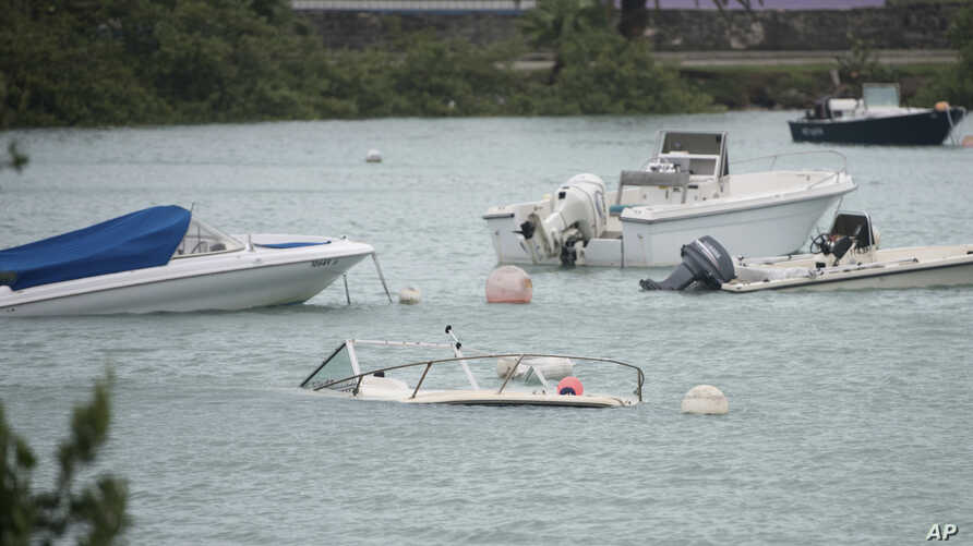 Swamped boats sit in Mullet Bay after the passing of Hurricane Nicole in St. Georges, Bermuda, Oct. 13, 2016. Hurricane Nicole roared across Bermuda, pummeling the resort island with winds that snapped trees and peeled off roofs before the storm spun