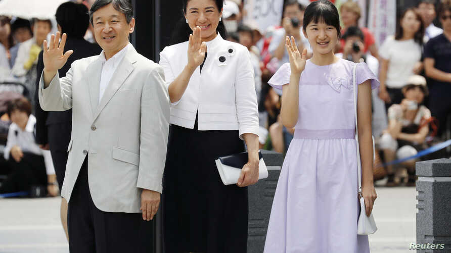 Japan's Crown Prince Naruhito, from left, his wife Crown Princess Masako and their daughter Princess Aiko wave as they arrive at a train station in Matsumoto, Nagano Prefecture, Japan, Aug. 10, 2016.