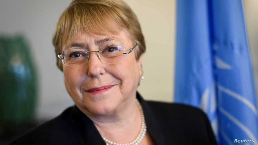 Former Chilean president Michelle Bachelet poses in her office at the Palais Wilson on her first day as new United Nations (UN) High Commissioner for Human Rights in Geneva, Switzerland, Sept. 3, 2018.