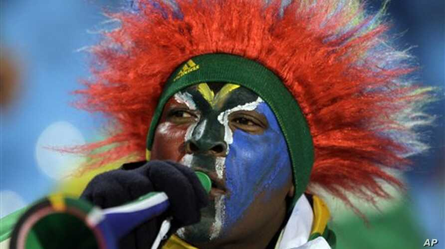 A South African soccer fan blows a vuvuzela  in Pretoria, 16 Jun 2010
