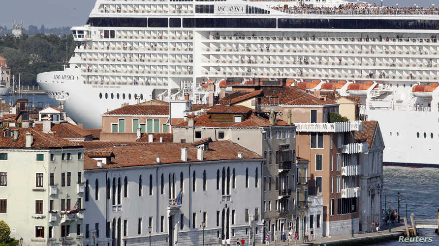 FILE - The MSC Musica cruise ship is seen in Venice lagoon June 17, 2012. Since the wreck of the Costa Concordia, environmentalists have stepped their efforts to have large cruise ships banned from the lagoon which surrounds the historic centre of th