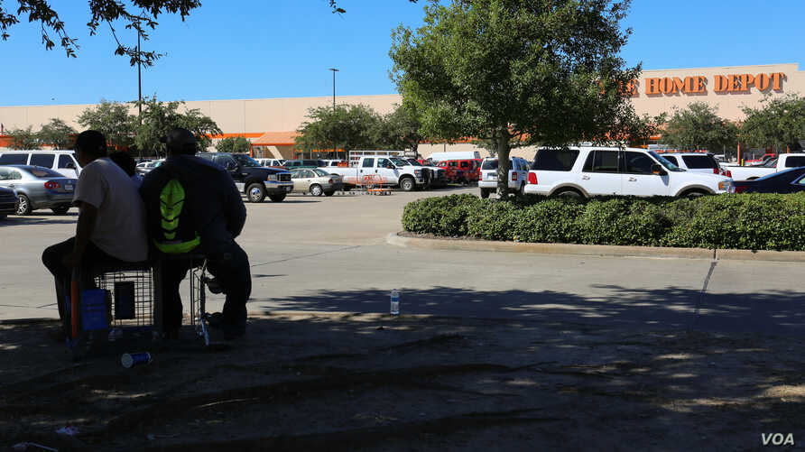 In north Houston, a group of mostly undocumented, Latino men wait outside a Home Depot, in search of manual cleanup work.