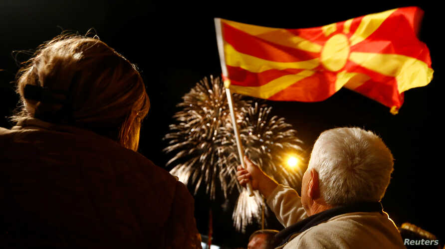 Supporters of the ruling Social Democratic Union of Macedonia wave a Macedonian flag during victory celebrations for the local elections in Skopje, Macedonia, Oct. 16, 2017.