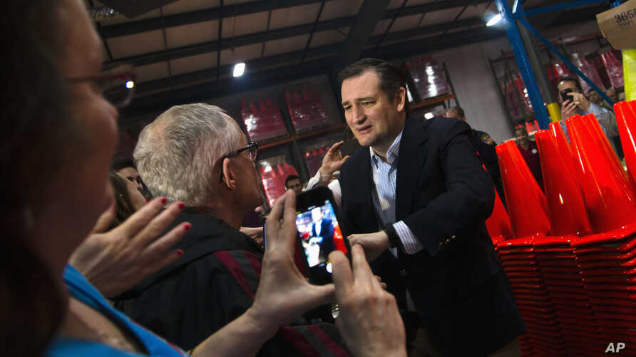 Republican presidential candidate, Sen. Ted Cruz greets supporters before speaking at a campaign stop, March 25, 2016, in Oshkosh, Wis.