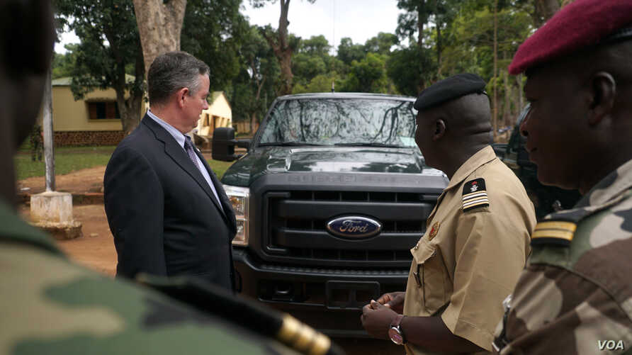 The U.S. Ambassador to Central African Republic Jeffrey Hawkins and the  Central African Republic's  deputy chief of staff for planning, Lieutenant Colonel Ishmael Koagu, check out a trucks being provided by the U.S. government to the C.A.R. army. (Z