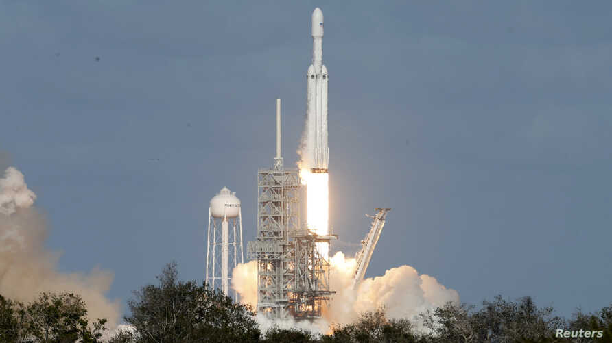 A SpaceX Falcon Heavy rocket lifts off from historic launch pad 39-A at the Kennedy Space Center in Cape Canaveral, Florida, Feb. 6, 2018.