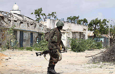 A Ugandan African Union peacekeeper patrols an empty street in the Wardigley district of southern Mogadishu,  August 7, 2011
