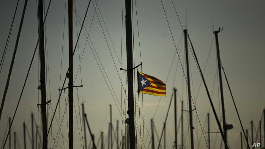 "An ""estelada,"" or Catalonia independence flag, waves on a mast of a boat at the port of Vilanova i La Geltru, Spain, Oct. 31, 2017."