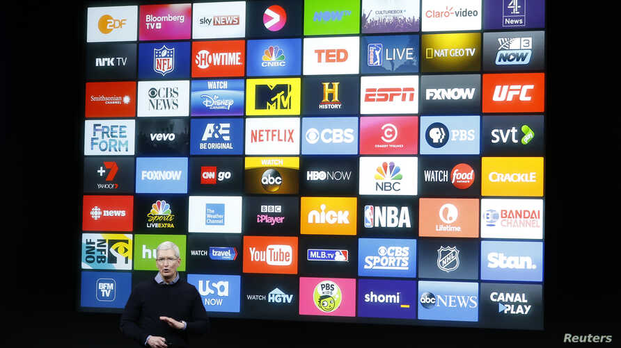 FILE - Apple CEO Tim Cook speaks about the Apple TV during an event at Apple headquarters in Cupertino, California, March 21, 2016.