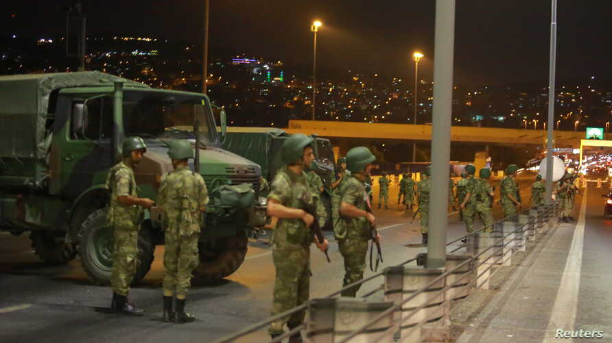 Turkish military block access to the Bosphorus bridge, which links the city's European and Asian sides, in Istanbul, Turkey, July 15, 2016.