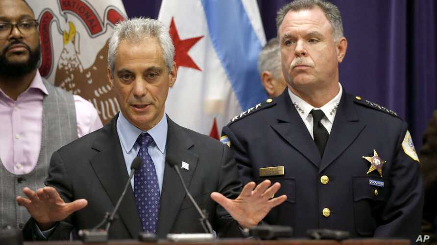 FILE - Chicago Mayor Rahm Emanuel (R) and Police Superintendent Garry McCarthy appear at a news conference in Chicago Nov. 24, 2015.