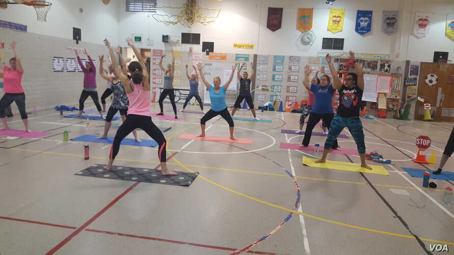 Teachers at Gunpowder Elementary school in Baltimore, MD, take part in a fitness class designed to reduce stress.
