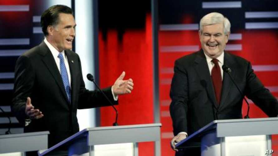 Republican presidential candidates former Massachusetts Gov. Mitt Romney, left, and former Speaker of the House Newt Gingrich, right, during the Republican debate,  in Des Moines, Iowa, December 10, 2011.