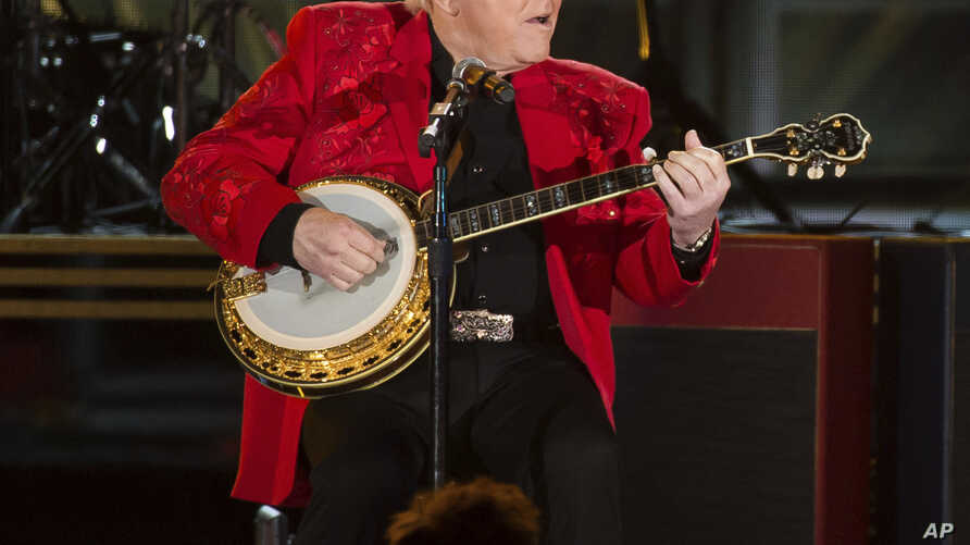 FILE - Roy Clark performs at the 50th annual CMA Awards at the Bridgestone Arena on Nov. 2, 2016, in Nashville, Tenn.