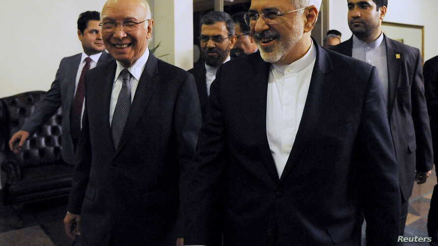 Sartaj Aziz, left, adviser to Pakistan's prime minister on foreign affairs, escorts Iranian Foreign Minister Javad Zarif before their meeting at the Foreign Ministry in Islamabad, April 8, 2015.