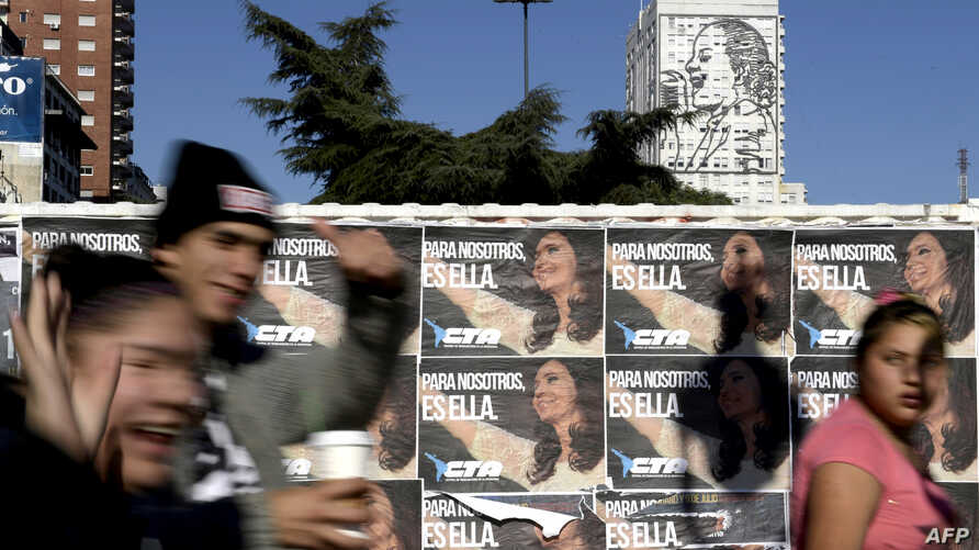 """Wall posters reading """"For Us, It's Her"""" in reference to former Argentine president Cristina Kirchner, in downtown Buenos Aires, Argentina, June 14, 2017. Kircher on Wednesday announced the formation of a new party."""