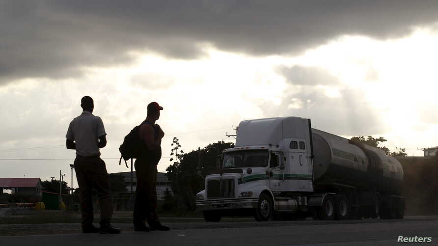 A tanker truck travels on a road in Mayabeque province, Cuba, Oct.15, 2015.