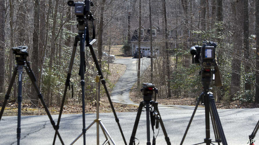 Television news cameras are lined up outside of the house where Germanwings A320 plane crash victim Yvonne Selke is presumed to have lived in Nokesville, Virginia, March 25, 2015.