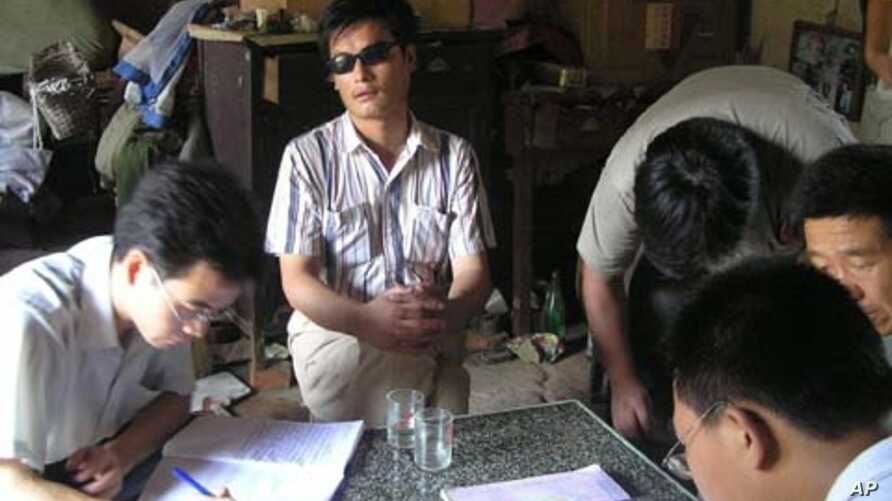 In this undated photo released by his supporters, blind activist Chen Guangcheng, center, is seen in a village in China.
