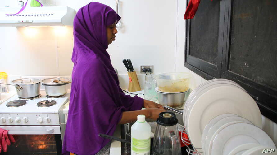 A refugee from Somalia, who had attempted suicide, doing kitchen chores at Camp Five on the Pacific island of Nauru, Sept. 2, 2018.