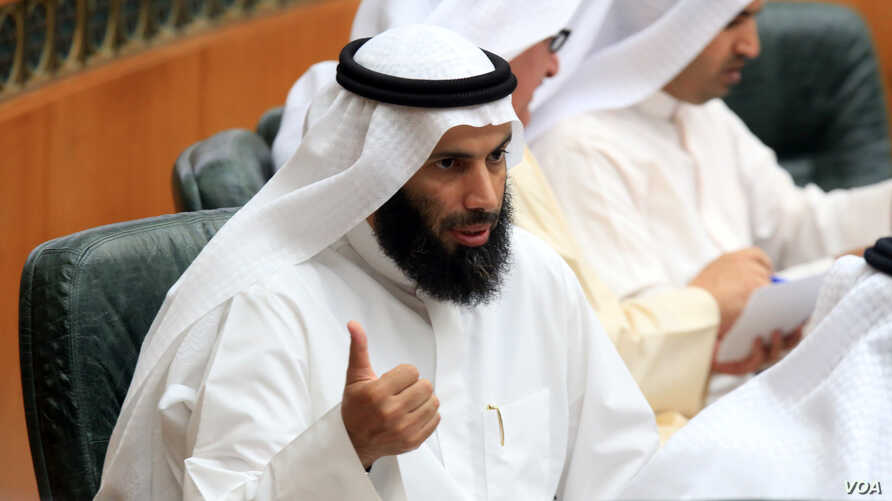 FILE - Former Kuwaiti Minister of Justice, Awqaf (Islamic endowments) and Islamic Affairs, Nayef al-Ajmi speaks in a parliament session at Kuwait's National Assembly. Ajmi resigned in the wake of accusations by a senior U.S. official that he was enab