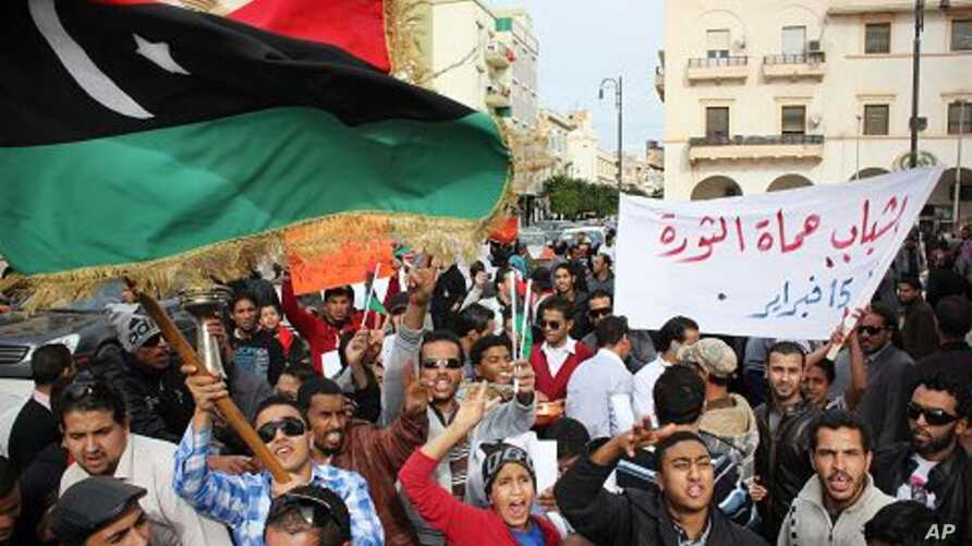 Men chant slogans during a protest in Benghazi, Libya, December 12, 2011.