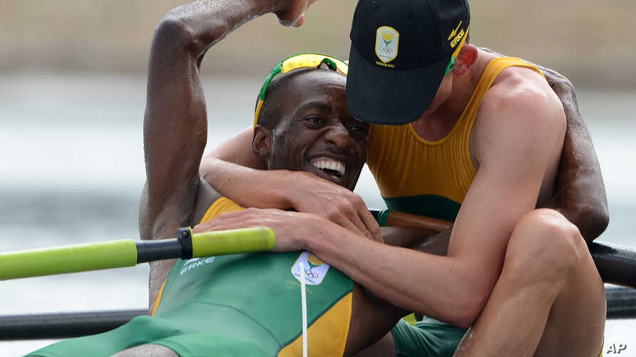 South Africa rowers Sizwe Ndlovu, left, and John Smith embrace after winning the gold medal in the men's lightweight four rowing final at the London 2012 Summer Olympics in Eton Dorney, near Windsor, England, August 2, 2012.