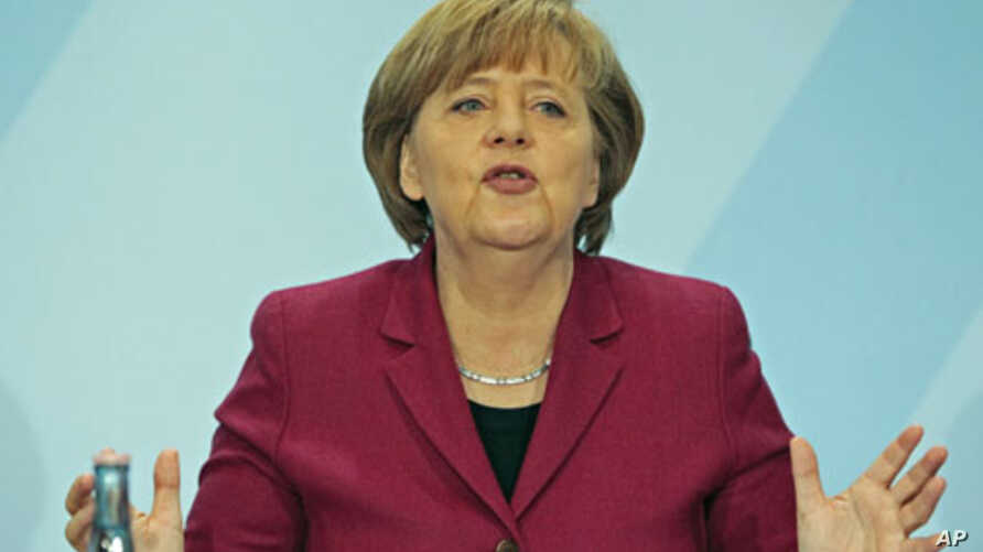 German Chancellor Angela Merkel speaks during a news conference in the Chancellery in Berlin, March 15, 2011