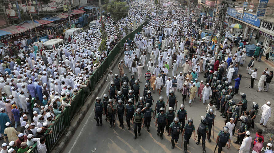 Bangladeshi activists of several Islamic groups attend a protest rally against the persecution of Rohingya Muslims in Myanmar, after Friday prayers in Dhaka, Bangladesh, Nov. 25, 2016. Myanmar does not recognize the Rohingya as citizens, though they'