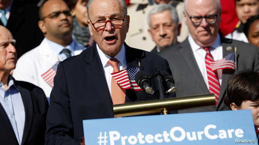 FILE - Senate Minority Leader Chuck Schumer speaks at an event marking the seventh anniversary of the passing of the Affordable Care Act outside the Capitol Building in Washington, March 22, 2017.