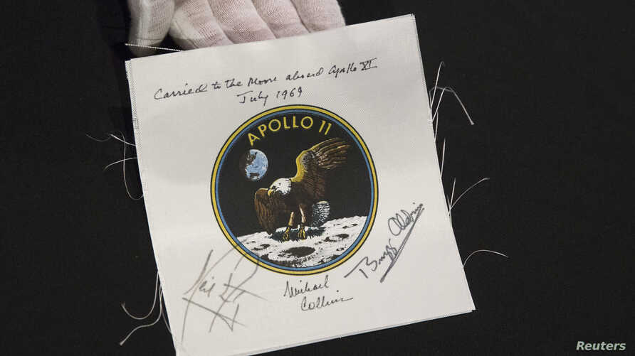 An Apollo 11 emblem, flown into lunar orbit and signed by the crew - Neil Armstrong, Michael Collins, and Buzz Aldrin, which is estimated at $40,000 to $60,000, is displayed as part of the upcoming Space History Sale at Bonham's auction house in New