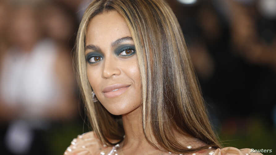 """FILE - Singer-Songwriter Beyonce Knowles arrives at the Metropolitan Museum of Art Costume Institute Gala (Met Gala) to celebrate the opening of """"Manus x Machina: Fashion in an Age of Technology"""" in the Manhattan borough of New York."""