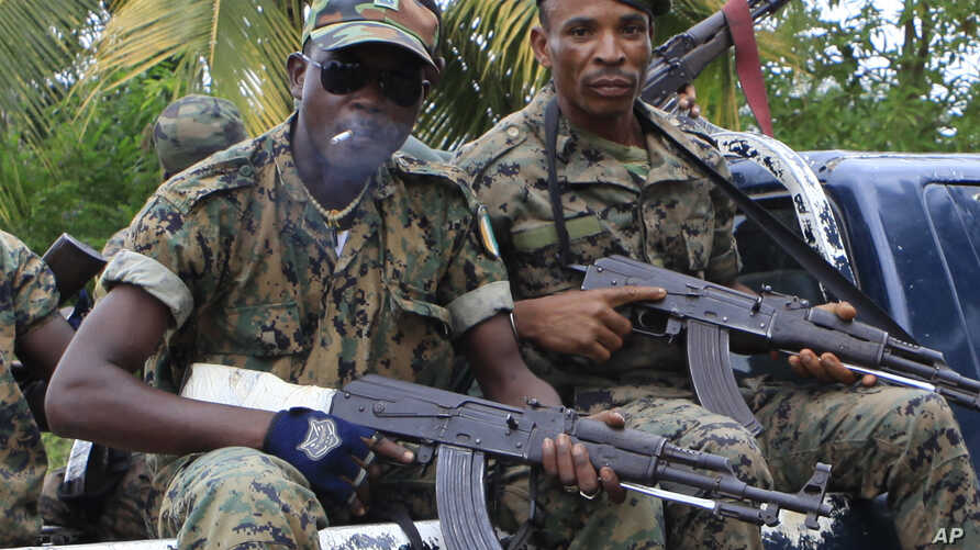 Republican forces troops allied with President Alassane Ouattara drive through the village of Keibly, just outside Blolequin in western Ivory Coast, May 31, 2011.