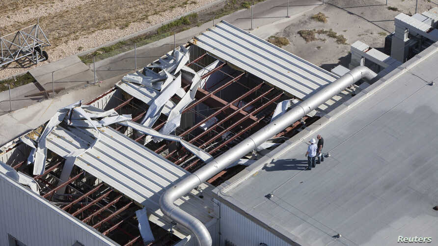 This photo provided by NASA, taken during an aerial survey of the Kennedy Space Center in Florida, shows hurricane damage to a support building, Oct. 8, 2016.