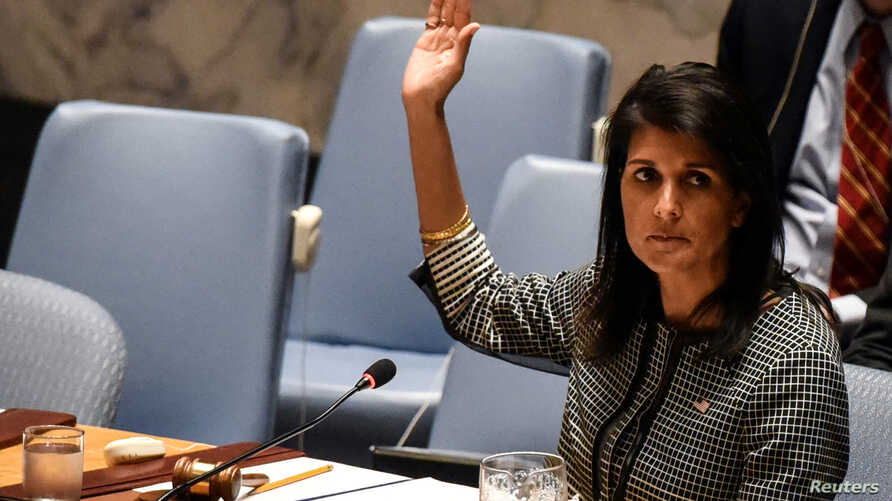 U.S. Ambassador to the U.N. Nikki Haley votes for a draft resolution condemning the reported use of chemical weapons in Syria at the Security Council meeting on the situation in Syria at the United Nations Headquarters in New York, April 12, 2017.
