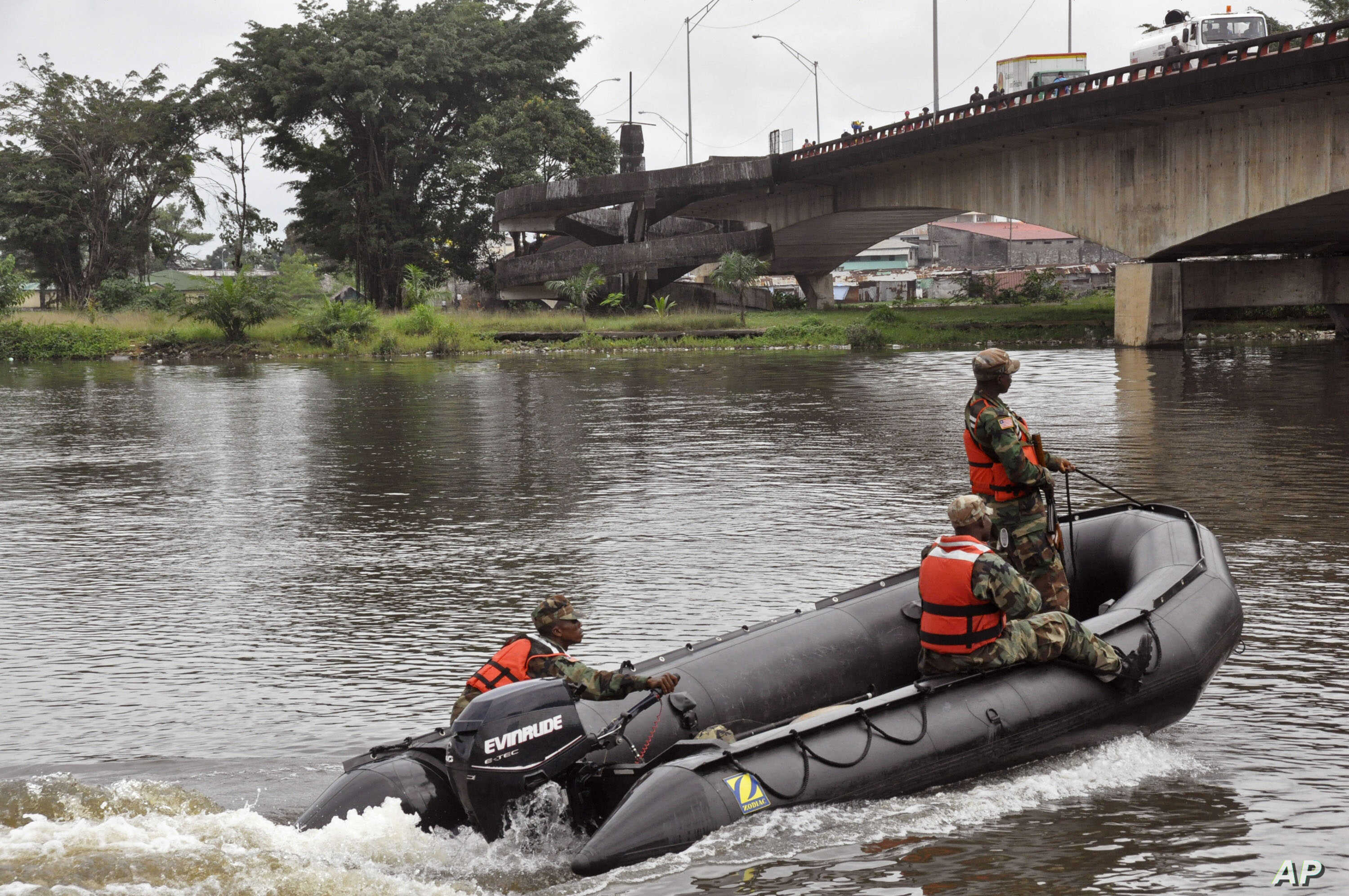 Liberian soldiers patrol the seaside of West Point a area that has been hit hard by the Ebola virus, with local residents not allowed to leave the West Point area,  as government forces clamp down on movement to prevent the spread of Ebola, in  Monro
