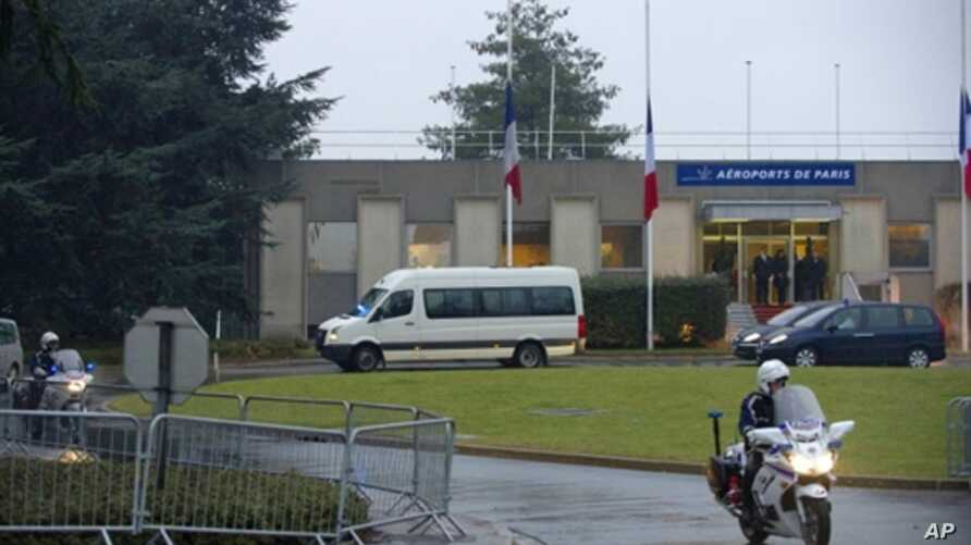 The funeral convoy leaves with the coffins of French nationals Vincent Delory and Antoine De Leocour, abducted and killed in Niger over the weekend, after their arrival at Paris' Roissy Charles de Gaulle airport, 12 Jan 2011