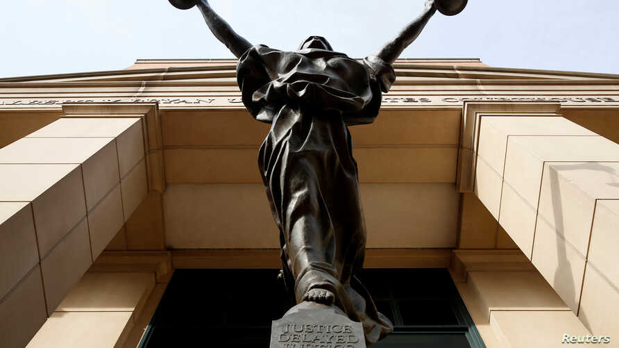The statue of Lady Justice stands at the Federal Courthouse in Alexandria, Va., Aug. 17, 2018.