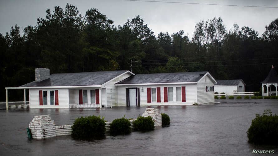 A house is seen flooded by rain after Hurricane Florence swept through the town of Wallace, North Carolina, Sept. 15, 2018.