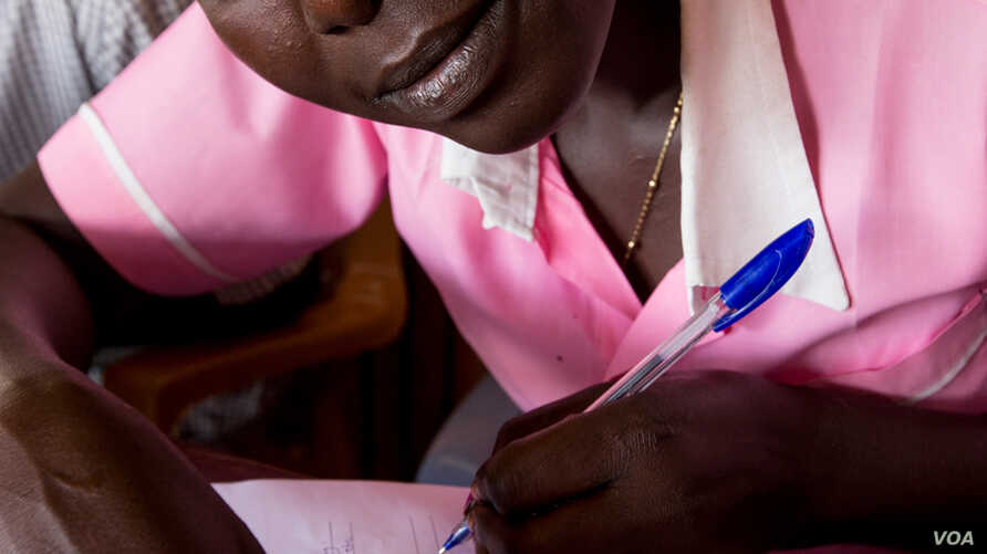A displaced girl sits a school-leaving exam at the U.N. compound in Juba in January, 2014. The exams, which were due to begin on Dec. 16, were delayed when fighting broke out in the capital.