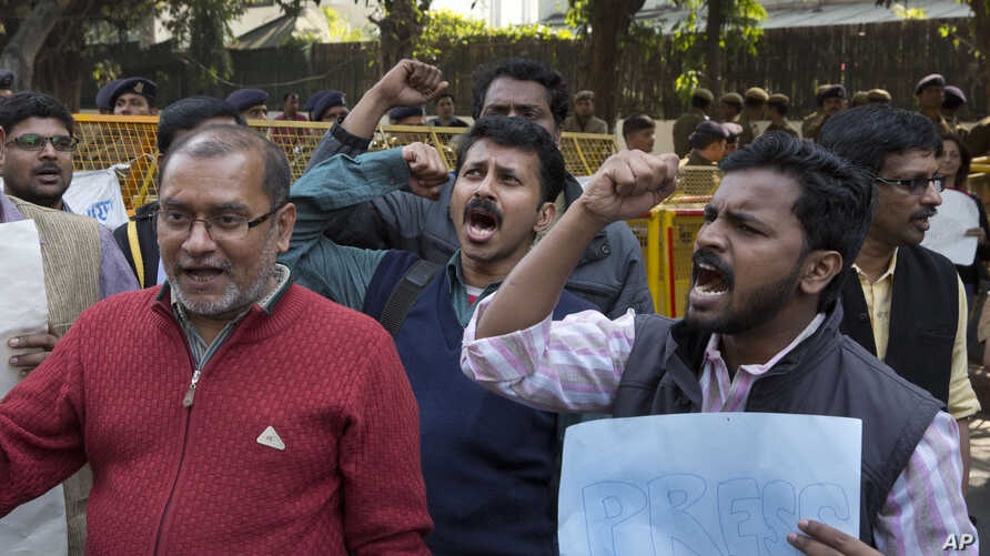 Indian journalists shout slogans for the freedom of press near Supreme Court in New Delhi, India Tuesday, Feb. 16, 2016.