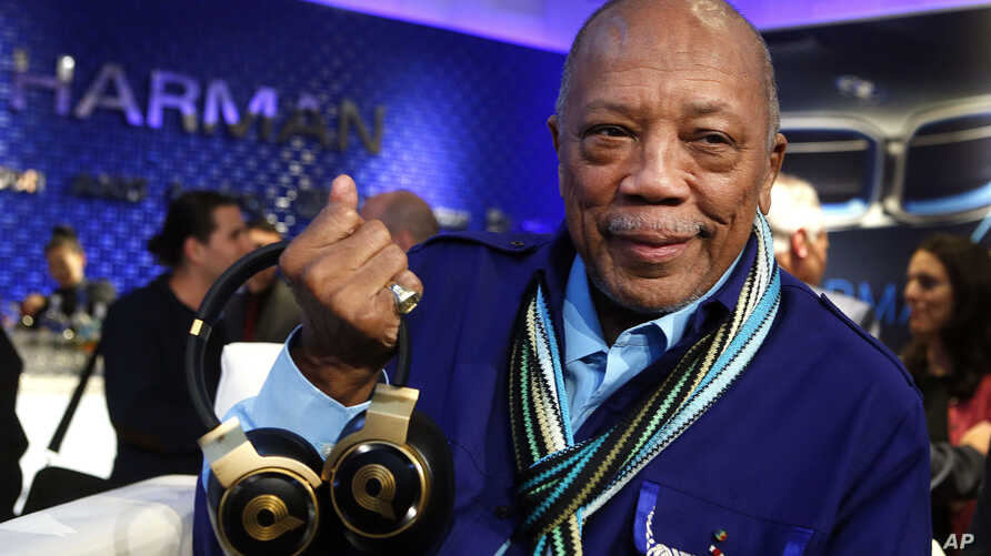 FILE -  Quincy Jones unveils his new N90Q headphones from AKG, the world's first headphones with personalized sound, at the HARMAN flagship store in New York.