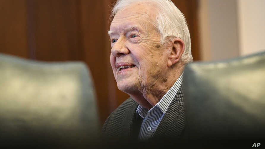 FILE - Former President Jimmy Carter, 93, sits for an interview about his latest book, April 11, 2018, in Atlanta.