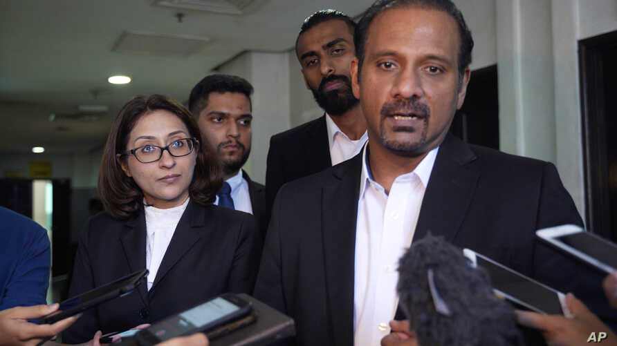 Ramkarpal Singh, far right and Sangeet Kaur Deo, far left, lawyers of the family of a murdered Mongolian model Altantuya Shaariibuu, speaks to the press in Shah Alam, Malaysia, Wednesday, Jan. 23, 2019.