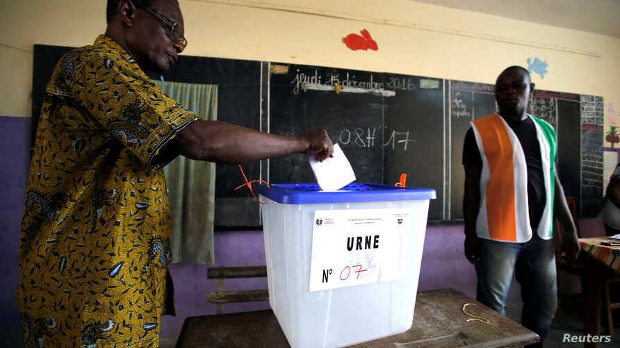 A man casts his vote at a polling station during the legislative elections in Abidjan, Ivory Coast, Dec. 18, 2016.