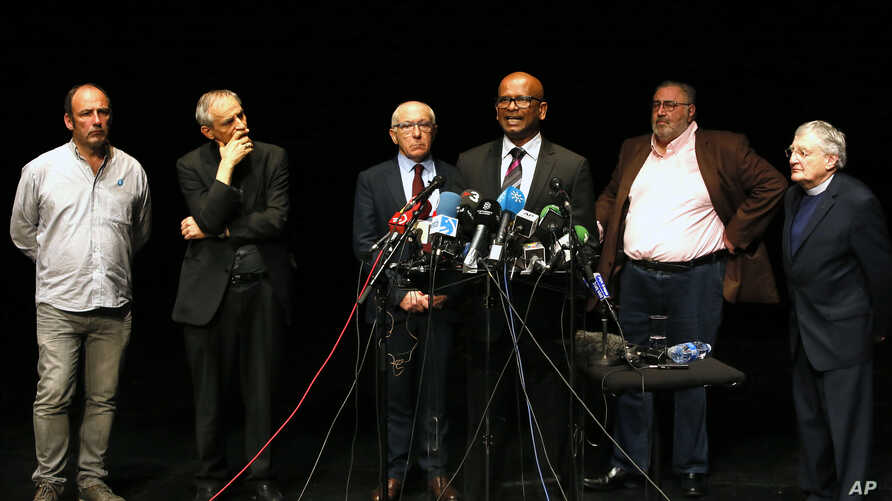 Ram Manikkalingam, third right, president of the Verification Commission for disarmament of ETA, the Basque armed separatist group, announces delivery of ETA weapons to French authorities, surrounded by others, from left, peace activist Jean-Noel Etc