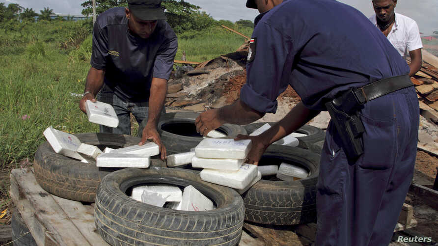 FILE - Police pile up confiscated cocaine and marijuana in Paramaribo, April 19, 2011. Authorities in Suriname have made their largest ever seizure of cocaine, a law enforcement official said Wednesday.