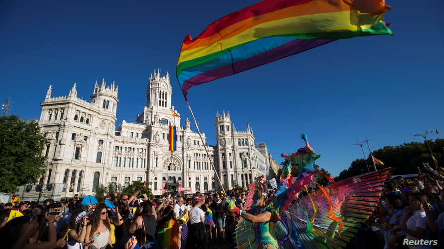 Revelers attend the World Pride parade in Madrid, Spain, July 1, 2017.