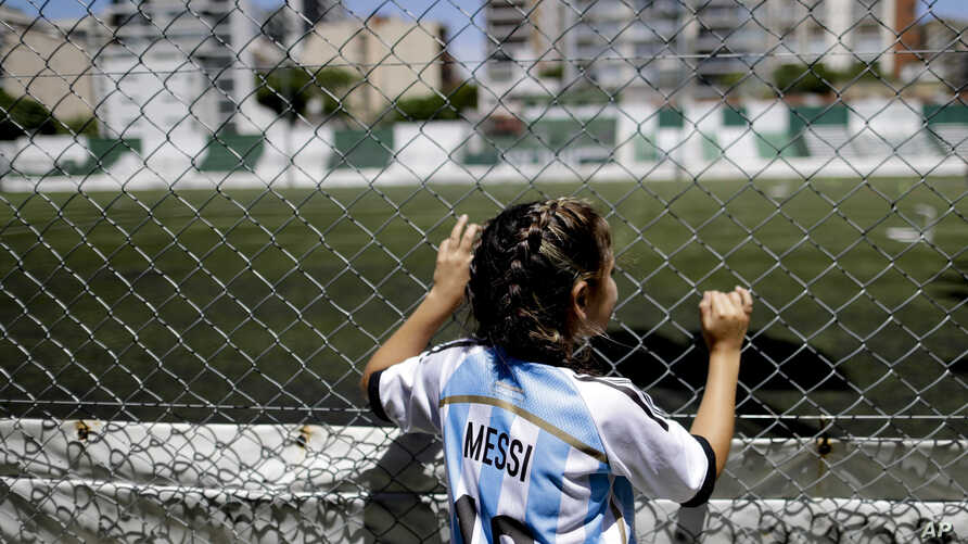FILE - Candelabra Villegas, 12-year-old, poses for a photo wearing Lionel Messi's national team jersey, in Buenos Aires, Argentina, Jan. 31, 2019.